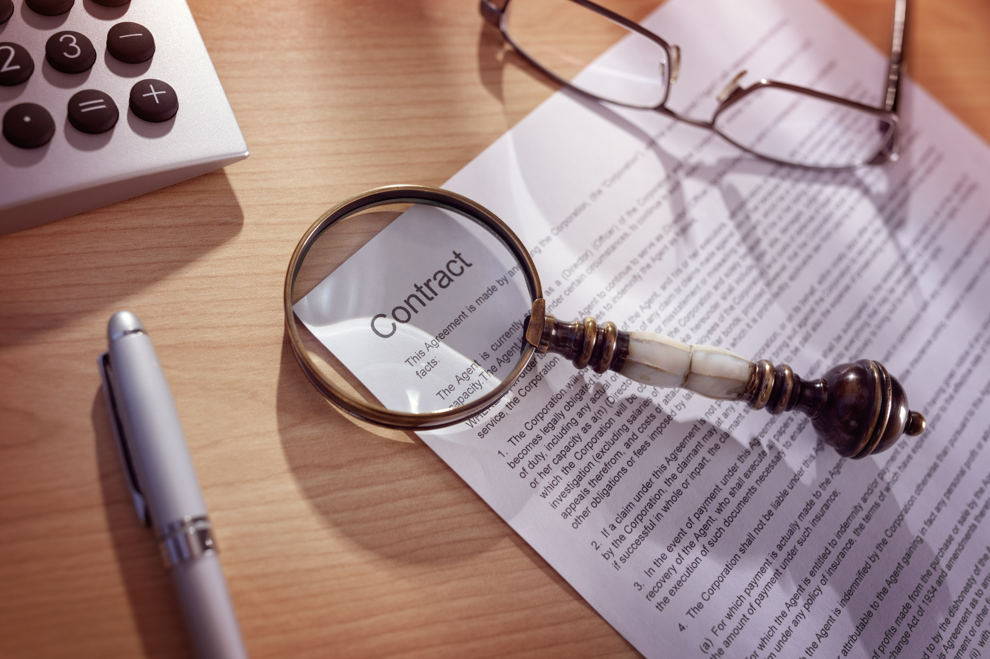 Magnifying glass on a legal contract